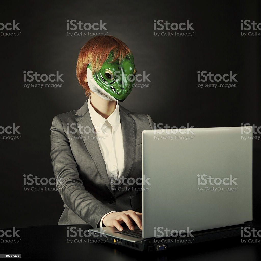 "I am working) ""Businesswoman in frog mask working, toned image"" Adult Stock Photo"