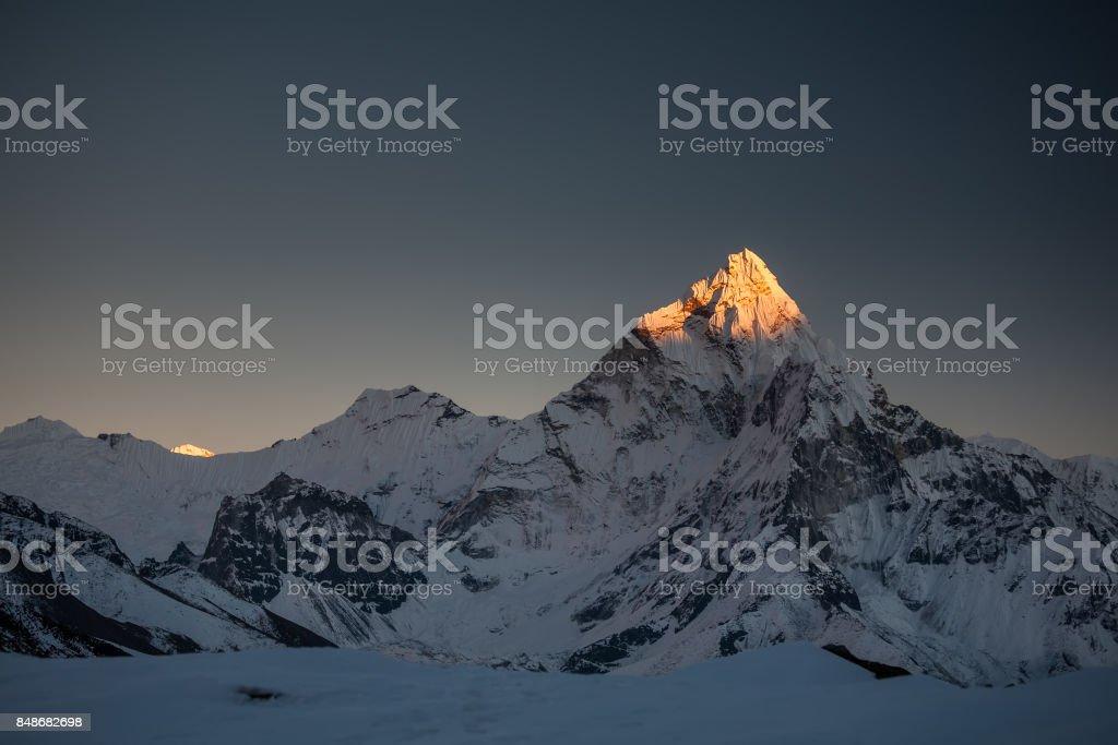 Amadablam peak at sunset in Khumbu valley in Nepal, Himalayas stock photo