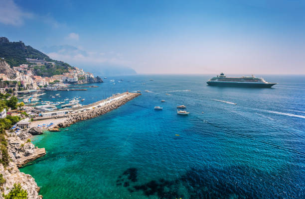 Amalfitan coast with cruise liner Cruise liner near Salerno Amalfitan coast in Italy mediterranean sea stock pictures, royalty-free photos & images