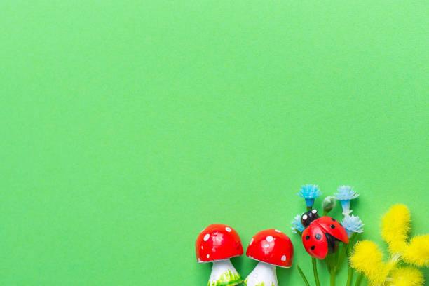 Amanita mushrooms small blue forget me not yellow mimosa flowers on picture id932353750?b=1&k=6&m=932353750&s=612x612&w=0&h=s3qtzlglb0m155e185l2x3ajrdczj9mafp5vsk56lmq=