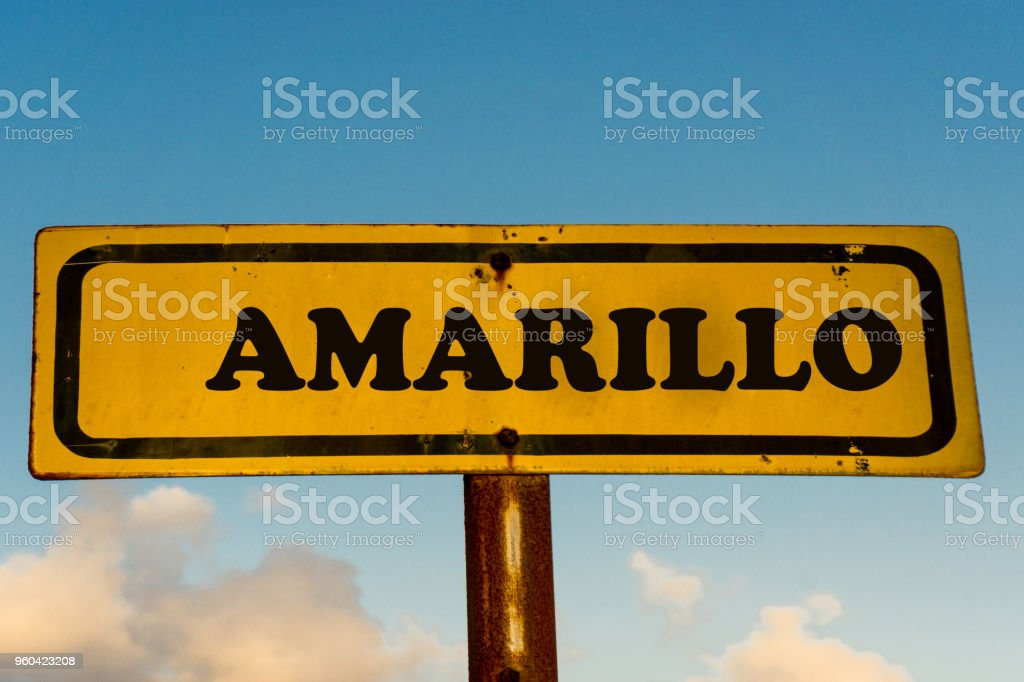 Amarillo city street old antique yellow sign with blue sky at background, USA signal city series. stock photo