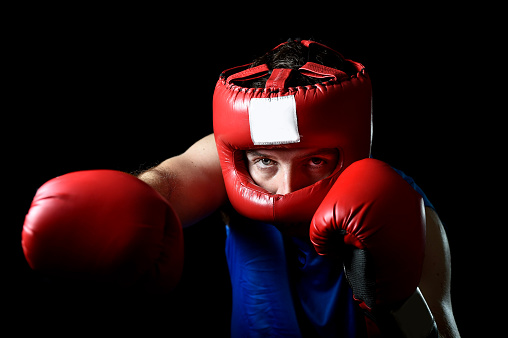 Amateur Boxer Man Fighting In Boxing Gloves And Headgear ...