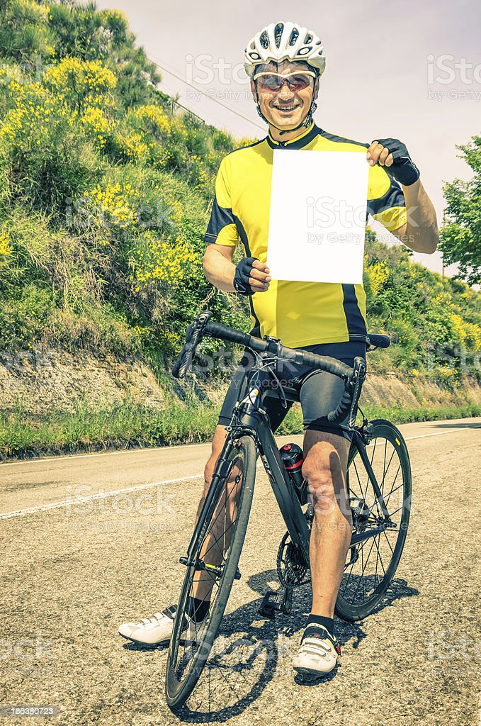Amateur Cyclist with blank Sheet stock photo