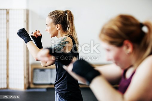 istock Amateur Kickboxers Shadow Boxing Together 970123320