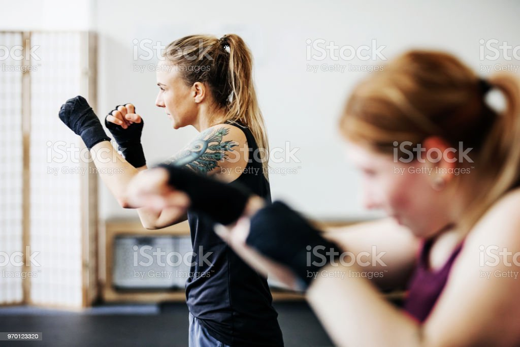 Amateur Kickboxers Shadow Boxing Together stock photo