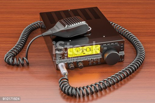 istock Amateur radio transceiver with push-to-talk microphone switch on the wooden table. 3D rendering 910171524