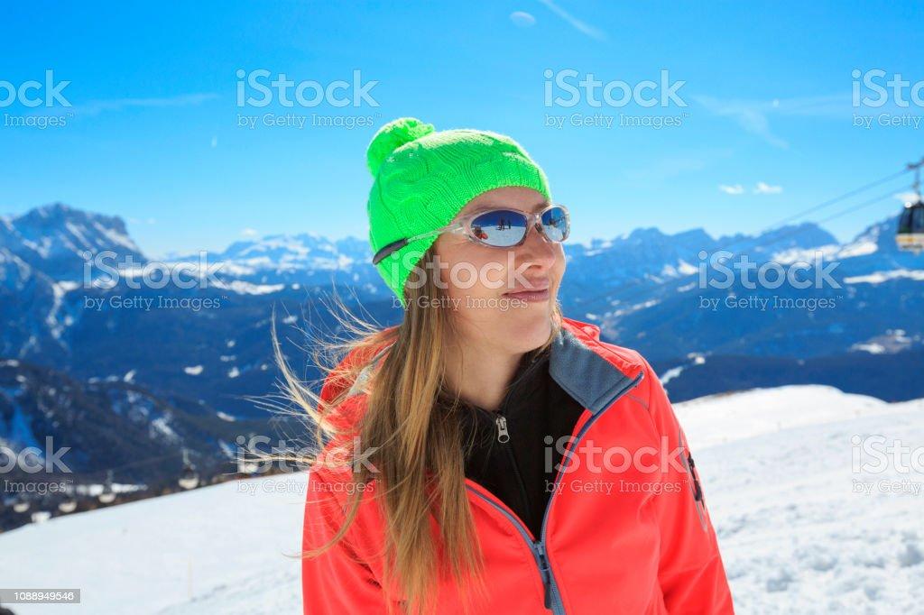 Amateur Winter Sports alpine skiing. Blonde women snow skiers...