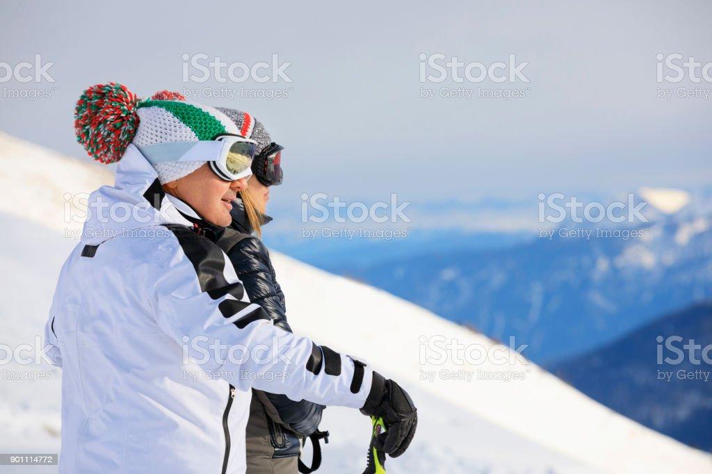 Amateur Winter Sports alpine skiing. Couple Best friends men and...