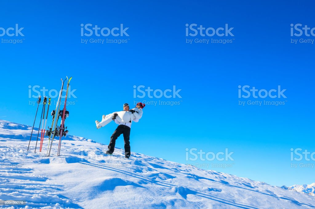 Amateur Winter Sports alpine skiing. Couple Best friends men and...