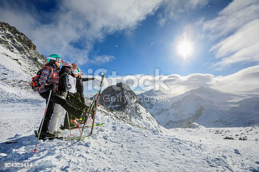 istock Amateur Winter Sports  alpine skiing. Group of skiers. Best friends men and women, snow skiers  enjoying on sunny ski resorts.  High mountain snowy landscape.  Italian Alps mountain of the Dolomites  Italy, Europe. 924329414