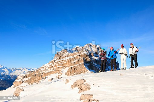 istock Amateur Winter Sports  alpine skiing. Group of skiers. Best friends men and women, snow skiers  enjoying on sunny ski resorts.  High mountain snowy landscape.  Italian Alps mountain of the Dolomites  Italy, Europe. Madonna di Campiglio. 942932962