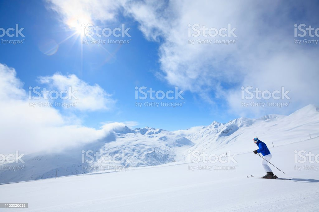 Amateur Winter Sports alpine skiing. Man snow skier skiing at ski...