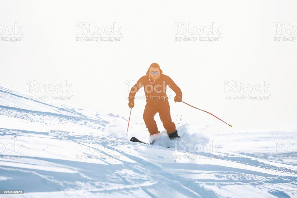 Amateur Winter Sports alpine skiing. Men , snow skiers, enjoying on...