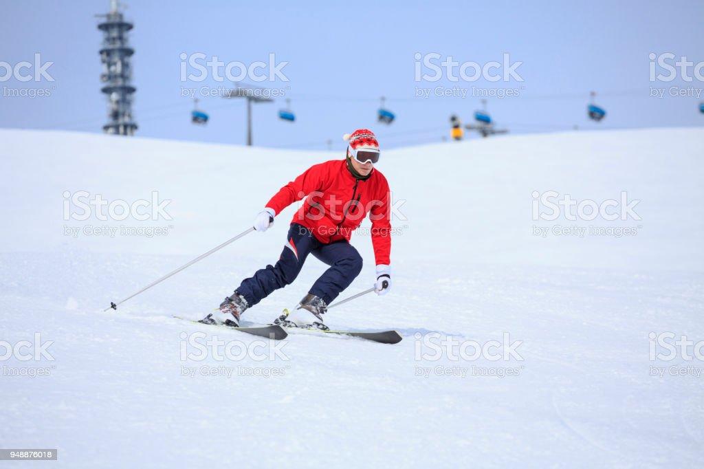 Amateur Winter Sports alpine skiing. Senior man skier skiing at sunny...