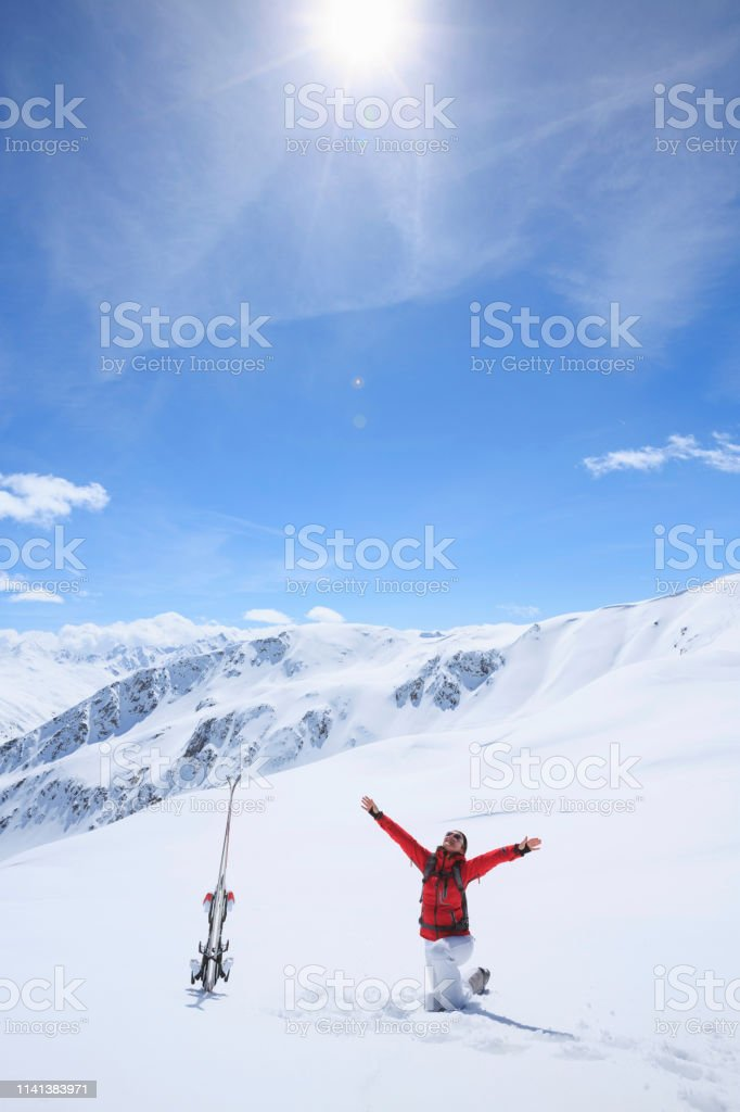 Amateur Winter Sports alpine skiing. Woman snow skier enjoy at sunny...
