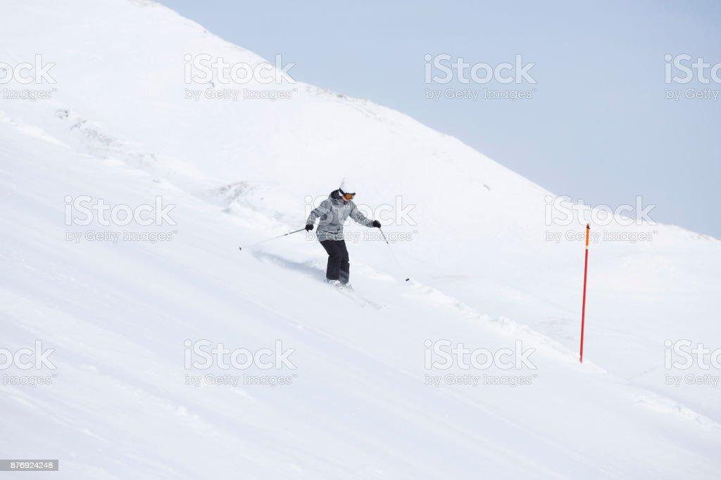 Amateur Winter Sports Girl skier skiing at ski resort Dolomites in...