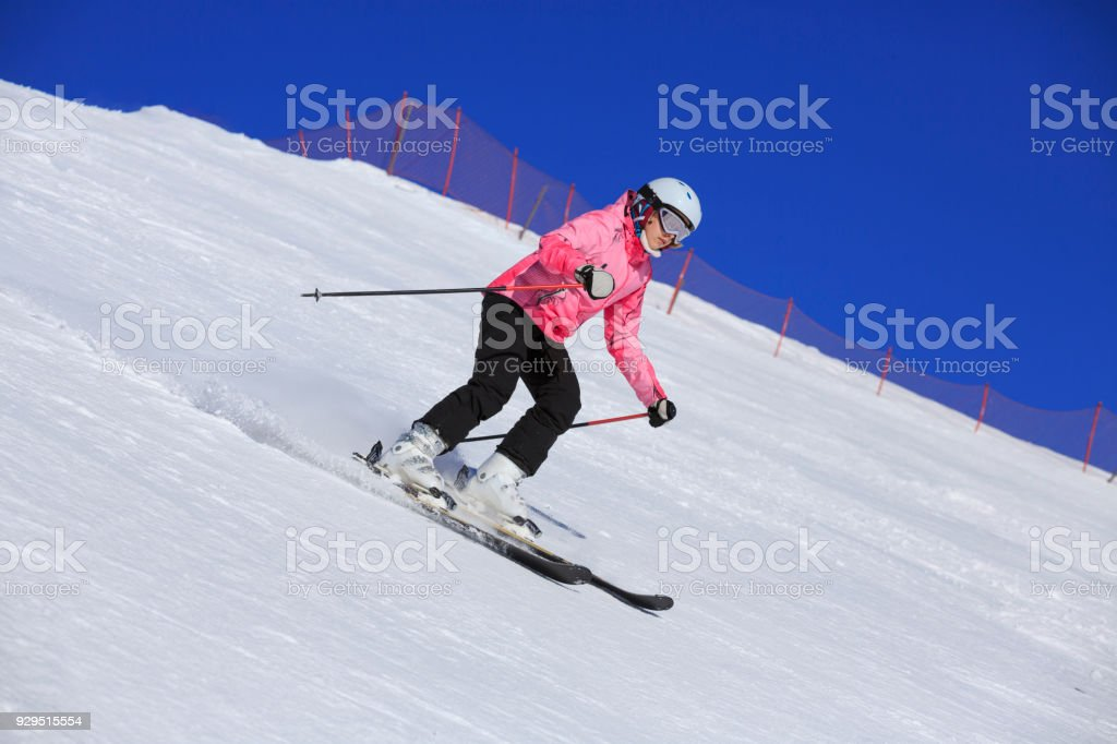Amateur Winter Sports Girl skier skiing at  ski resort Dolomites in Italy stock photo