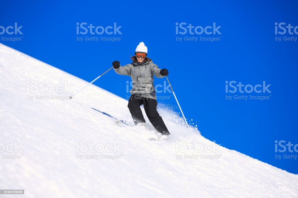 Amateur Winter Sports Girl skier skiing at sunny  ski resort Dolomites in Italy stock photo