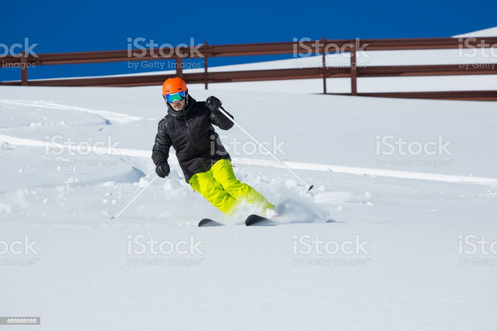 Amateur Winter Sports - good skier skiing in powder snow stock photo