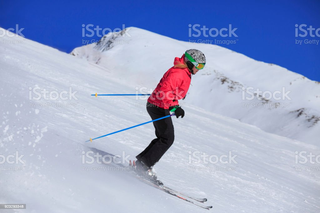 Amateur Winter Sports woman skier skiing at sunny  ski resort Dolomites in Italy stock photo