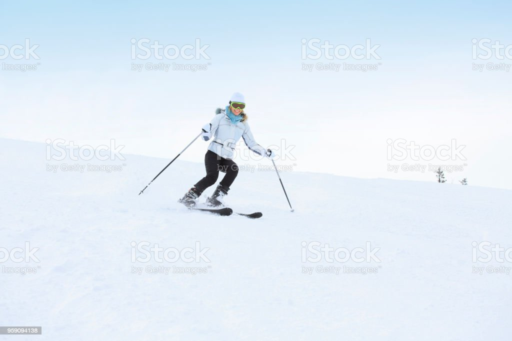 Amateur Winter Sports woman skier skiing