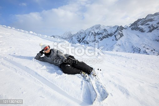 Amateur Winter Sports young woman skier skiing at sunny  ski resort Dolomites in Italy Passo Tonale