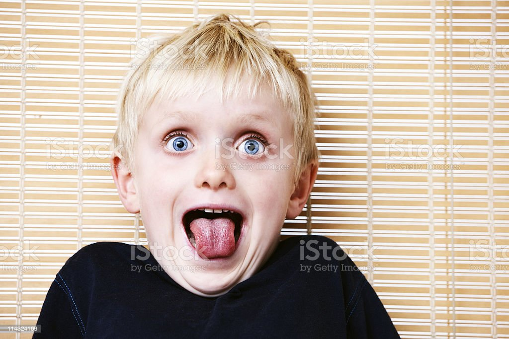 Amazed child with tongue out royalty-free stock photo