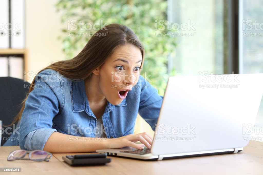 Amazed entrepreneur working on line stock photo