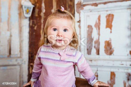 istock Amazed funny little girl with big eyes and plump cheeks 470843354