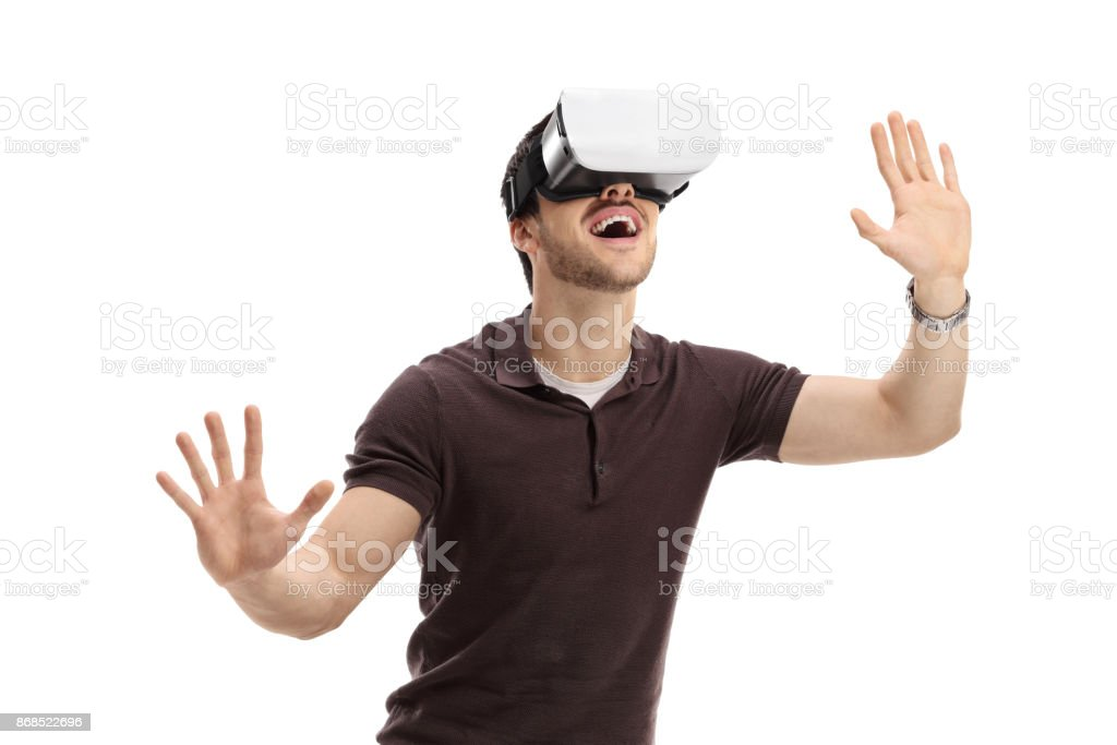Amazed guy using a virtual reality headset stock photo