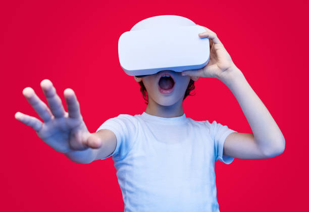 amazed kid experiencing virtual reality in glasses - vr red background imagens e fotografias de stock