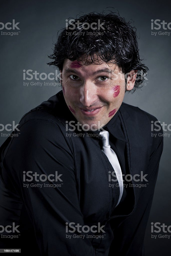 Close up of amazed kissed man face in business suit, over black...