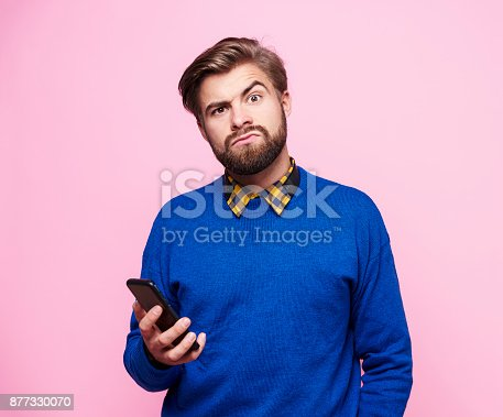 istock Amazed man with mobile phone 877330070