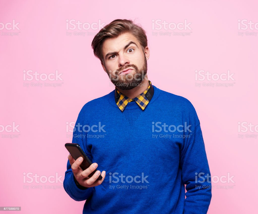 Amazed man with mobile phone stock photo
