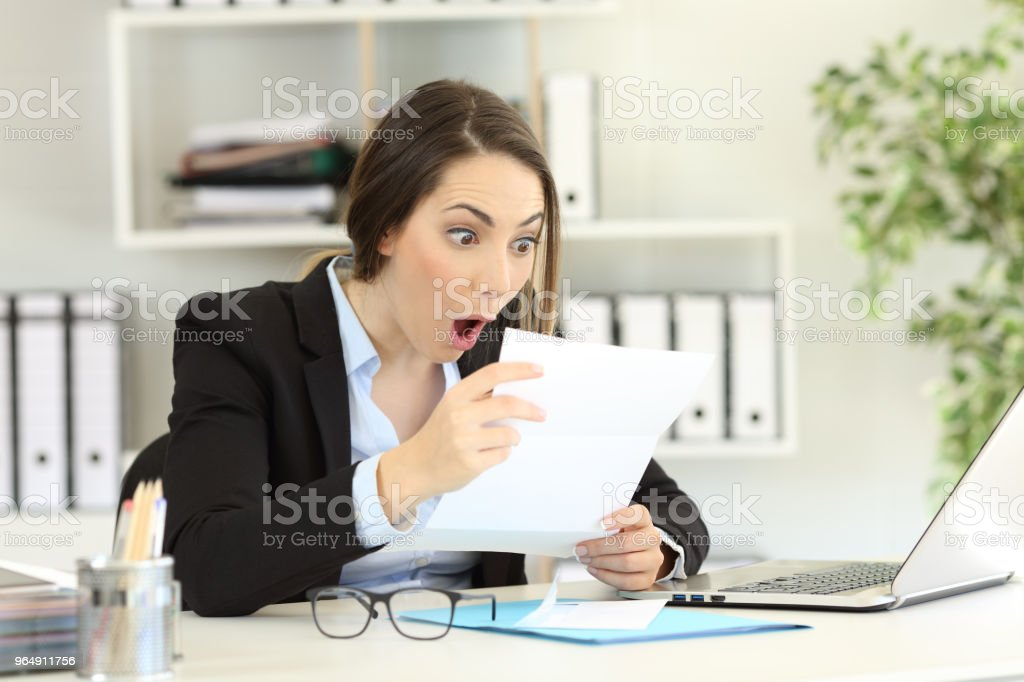 Amazed office worker reading a letter royalty-free stock photo