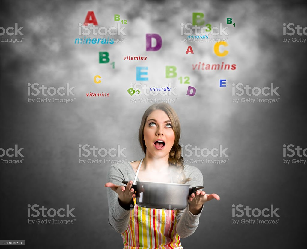 Amazed woman looking in colorful vitamins stock photo