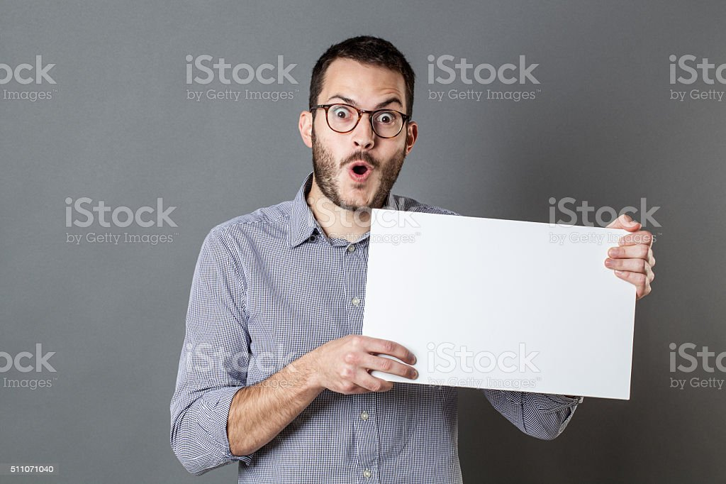 amazed young businessman holding blank banner for cool communication stock photo