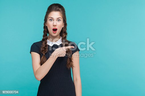 istock Amazement, wondered woman pointing finger right, at copy space. 925000704
