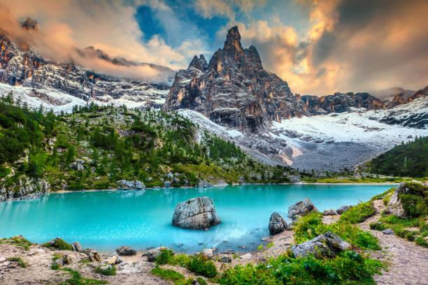 Amazing alpine landscape with turquoise glacier lake, Sorapis, Dolomites, Italy stock photo