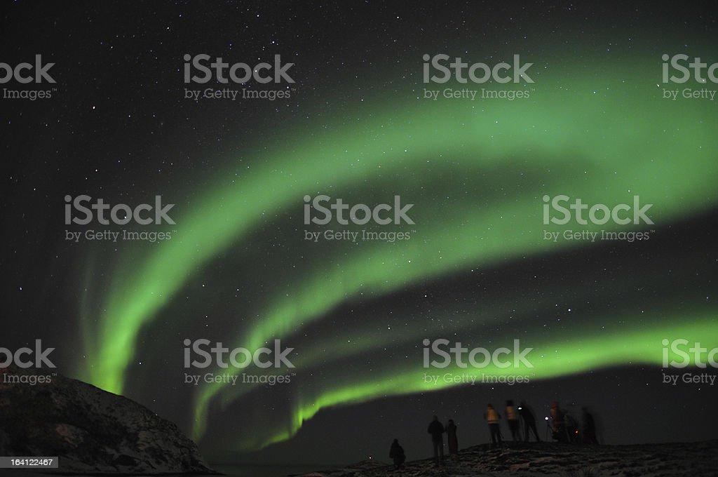 Amazing aurora borealis and a group of photographers royalty-free stock photo