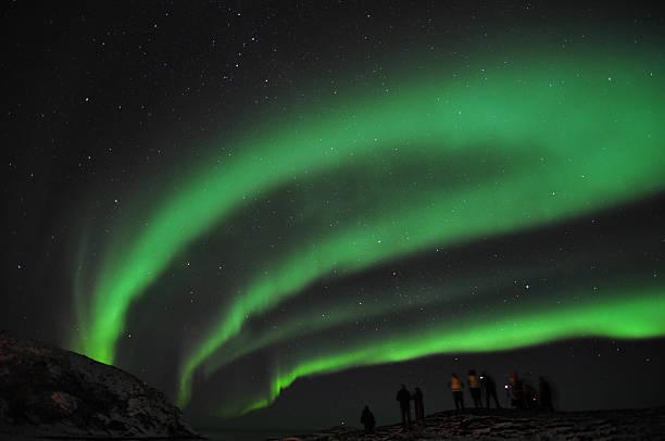 Amazing aurora borealis and a group of photographers stock photo