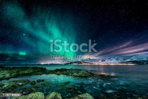 Amazing aurora borealis - northern lights - view from coast in Oldervik, near Tromso city -  north Norway
