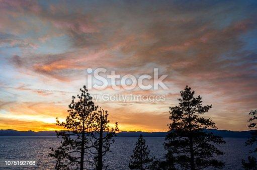 511675552 istock photo Amazing autumn sunset in Lake Tahoe, Nevada-USA 1075192768
