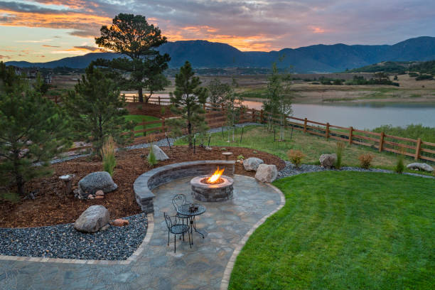 Amazing Backyard with Fire Pit Amazing Backyard with Fire Pit landscaped stock pictures, royalty-free photos & images