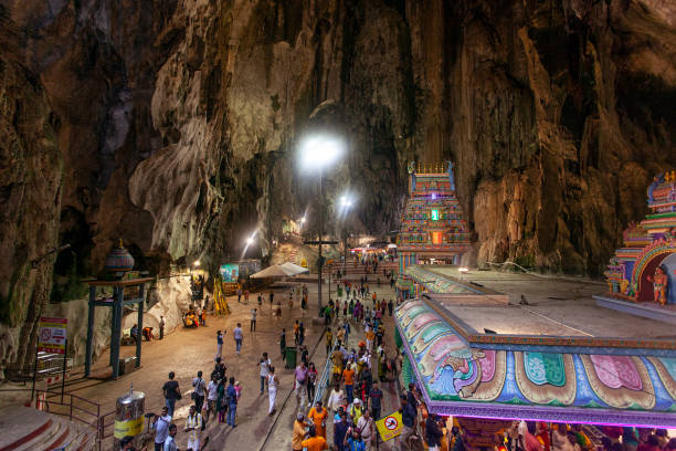 Amazing Batu caves with hindu temple and lots of pilgrims and tourists Amazing Batu caves with hindu temple and lots of pilgrims and tourists kuala lumpur batu caves stock pictures, royalty-free photos & images