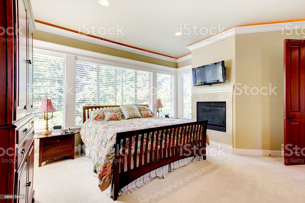 Amazing Bedroom Interior With Fireplace And Cherrywood Furniture Set Stock  Photo - Download Image Now