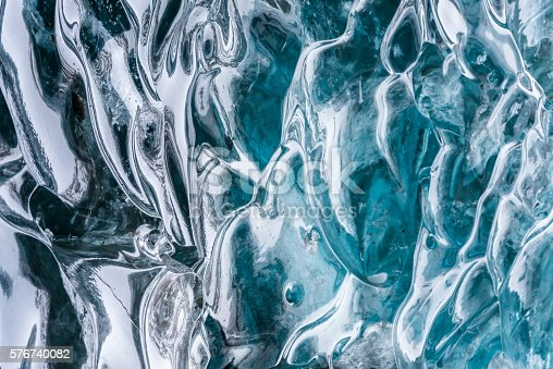 istock Amazing blue ice textura wall in the cave. Hofn. Iceland 576740082