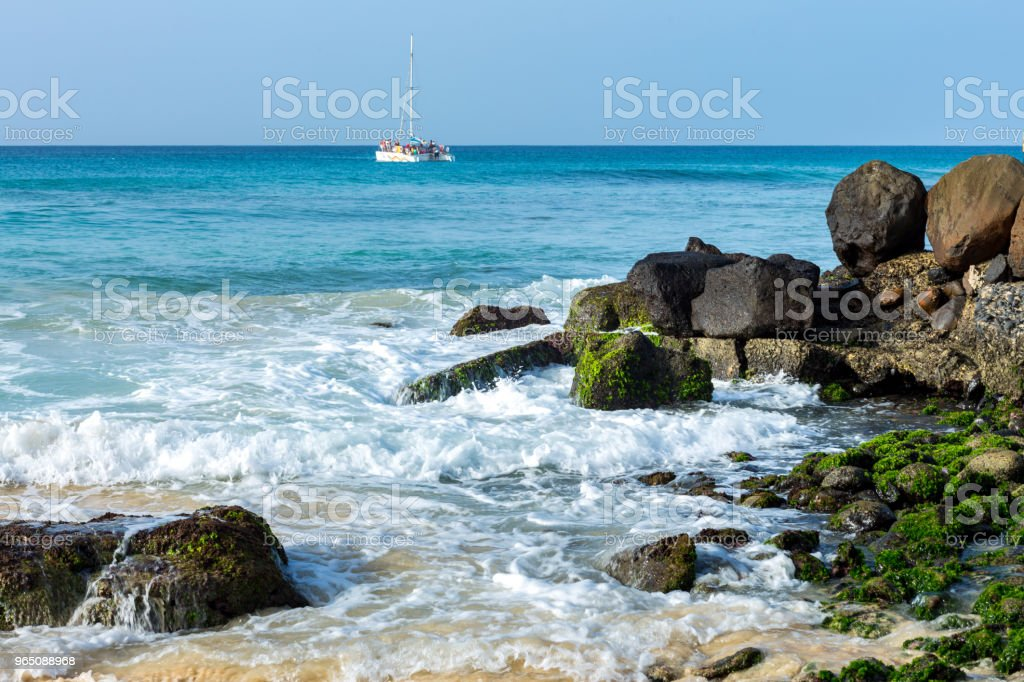 Amazing blue ocean with stone shore zbiór zdjęć royalty-free