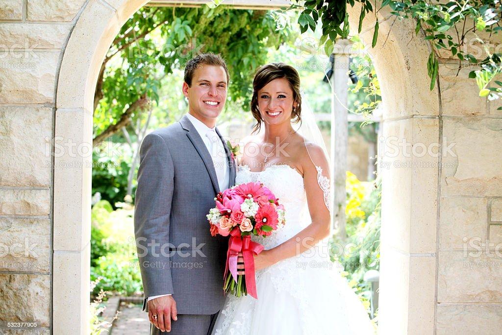 Amazing Bride and Groom Happy Wedding Dress Flowers stock photo