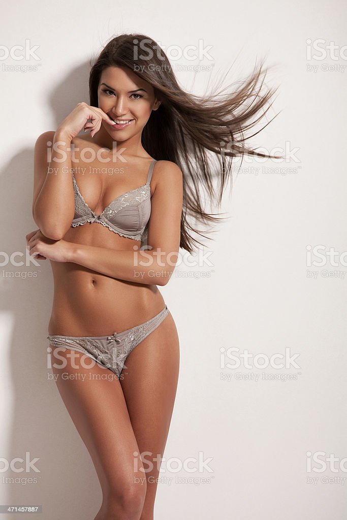 Amazing brunette posing in lingerie stock photo